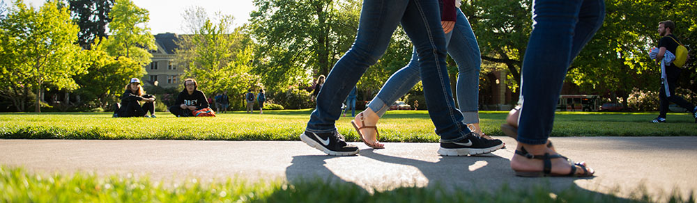 photo of feet walking across quad